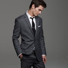 we're thinking dark grey tux, white shirt, with purple vest and tie and flower instead of napkin