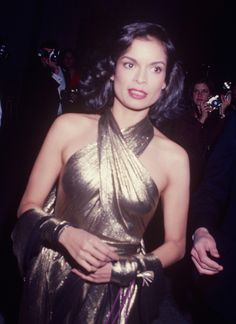 70s Disco Glam - Bianca Jagger in Fab Gold Glitter Halter Dress probably Halston