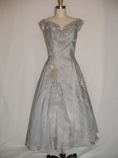 1950s Pale Blue Grey Beaded Silk Organdy Cocktail Dress. $50.00, via Etsy.