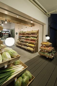 """Our goal was to create a minimalist space that is directly influenced by the power of the products: vegetables shipped directly from the Kyushu region. Inspiration came from the simple, fiercely utilitarian stores of Japan in the olden days, where the atmosphere is determined by the quality of the products themselves. The project proposes a new style of the traditional """"yaoya"""" (fruit and vegetable store) by reading into the way stores functioned in the past, and reformatting it to the…"""
