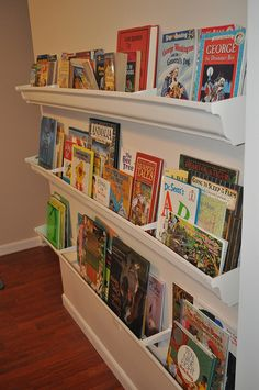 love these book shelves; they display all the colorful titles so that kids can see them!