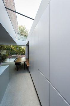 Providinga large, bright room to bring the outside in at ground floor level, this twostorey extension also provides additional bedrooms and bathrooms at first floorlevel. Theminimal framed glass screens open full width to the rear garden area from the kitchenarea...