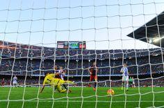 Neymar (L) of FC Barcelona scores his team's third goal during the La Liga match between FC Barcelona and Real Sociedad de Futbol at Camp Nou on November 28, 2015 in Barcelona, Catalonia.