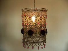 Burgundy Organza Handmade Flowers in a Delicate and Classic Lace Ceiling Light. $120.00, via Etsy.