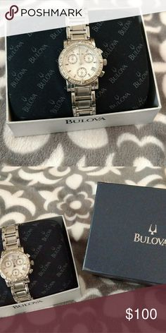 """Bulova watch Genuine Mother of Pearl Dial  24 Genuine Diamond Accents and Hour Markers  Date Window at the 3 o'clock position  Water Resistant to 30 Meters (100 Feet)  Brushed and Polished Stainless Steel Case and Bracelet  Bracelet features a Deployment Clasp  26mm Case Width (Approximately 1"""") Accessories Watches"""
