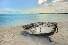 old row boat on the beach