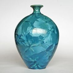 Vase of ovoid form with slender everted neck and blue crystalline glaze. Incised on base 'Rod Page'. 25 cm high and 14.5 cm in diameter.