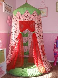 DIY hoola hoop fort. Could be a reading tent, or a secret hideaway, or a sleeping nook.