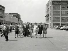 """Guys and Dolls Spring 1942. """"Detroit, Michigan. Girls coming out of the Highland Park Chrysler plant."""""""