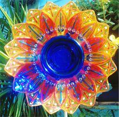 Glass plate flowers!  Giddy Garden Designs.  Find them on Facebook.