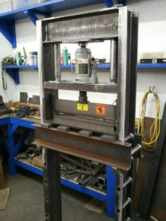"Shop Press by krugford -- Homemade shop press constructed from 6"" C-channel. Features sleeved cross-pins, a cylindrical guide system with integral springs, and bolted feet. Utilizes a 20-ton bottle jack, but can accommodate a 30-ton unit. http://www.homemadetools.net/homemade-shop-press-11"