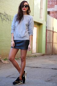 Leather mini skirt, sweatshirt and sneakers casual outfit