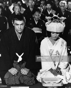 Actors Sean Connery and Mie Hama stage a fake Japanese wedding in a scene from the film 'You Only Live Twice', 1967.