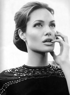 Angelina Jolie. Hands down, THE most beautiful woman in Hollywood. I don't care what anyone else says.
