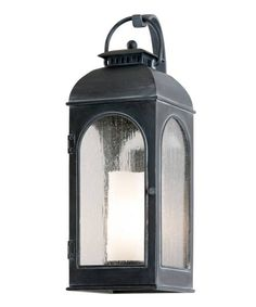This exterior light blends old-world styling with modern convenience.