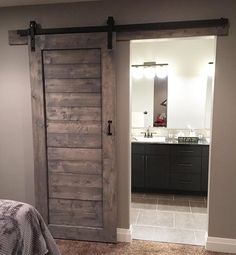 My clients have the most beautiful homes  here's a shot of a barn door install from last week / stained in weathered grey