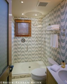 wavy mosaic tile is quirky and fun. prefer it in a different color though.