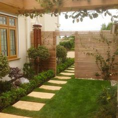 Western Red Cedar Slatted Screen defining boundary and privacy within a landscape