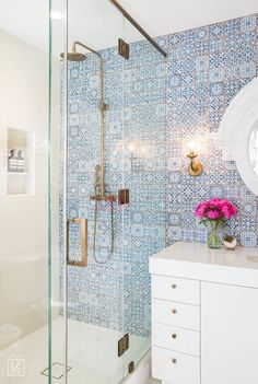 Love the vintage / old-world feel of this tile. And really love the vintage shower fixtures.