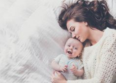 Like this for C's newborn session but the background black, me in black, C in white :-)