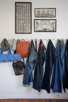 I know I dream of having my own closet room but I kind of love this men's denim displayed on hooks in the bedroom