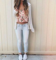 Rolled cuff light blue jeans, floral top, cute sporty flats.