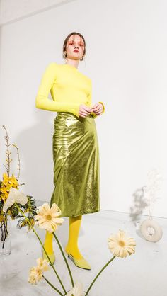 The Tullia skirt in lustrous foiled green. Concealed zip closure with elasticated waistband. Light weight. COMPOSITION AND CARE Dry Clean Do not bleach or tumble dry Please treat with care to extend t