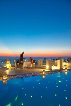 Dining above the Blu Resort on Santorini, Greece. Very romantic setting - pool!  ASPEN CREEK TRAVEL - karen@aspencreektravel.com