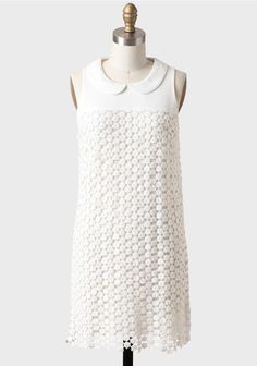 Perfected with a crocheted lace overlay, this white modern shift dress features a peter pan collar and an exposed back zipper closure. Finished with a scalloped hem, this delightful dress is ideal for a variety of spring and summer events and pairs well with wedges and heels. Fully lined. By Line & Dot.  Modern Lady Crocheted Dress By Line  Dot at #Ruche @Ruche