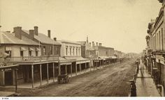 Family History Fossicking - This is a photo of Hindley street around 1870. The Blenheim Hotel is the one on the corner with the cart out the front. State Library of South Australia [B 1934]