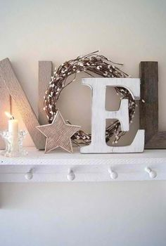 noel with wood letters and christmas wreath christmas fireplace decorations apartment christmas decorations decorating