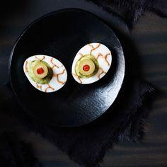 A Mexican twist on deviled eggs makes for a creepy Halloween appetizer. Recipe: Guacamoldy Eyeballs   - Delish.com