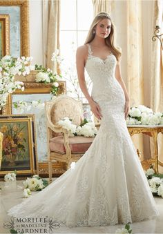 Wedding Dresses and Wedding Gowns by Morilee featuring Embroidered Lace on Soft Net with Wide Hemline Available in Three Lengths: 55 , 58 , 61 . Colors Available: White, Ivory, Ivory/Light Gold