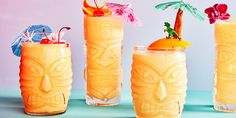 This twist on the piña colada uses frozen mango instead of pineapple for a delightfully smooth and indulgent cocktail. For optimal tiki fun, garnish the drinks with a classic tiki decoration.