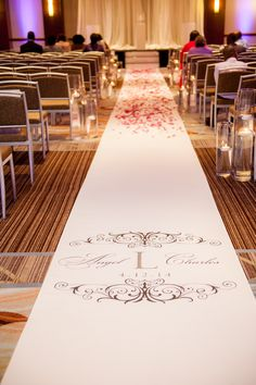Cute monogrammed aisle runner by Southern Event Planners in Memphis, TN
