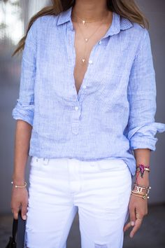 Button-down shirt, white jeans, and gold jewelry.