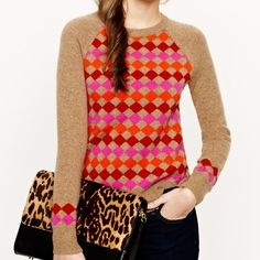 J. Crew Lambswool diamond sweater This J. Crew is stunning and features 100% Lambswool with a gorgeous tan background with red, orange and hot pink diamonds. J. Crew Sweaters Crew & Scoop Necks