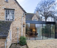 IQ Glass were featured on Real Homes online in a 'sourcebook for the top 50 extension essentials'. Yew Tree featured in this article to showcase a case study of a frameless IQ Glass were featured on Real Homes online in a 'sourcebook for the top 50 exten Extension Veranda, Cottage Extension, Glass Extension, Building Extension, Orangery Extension, Extension Ideas, Architecture Extension, Architecture Design, Living Haus