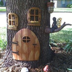 Give your garden elf a beautiful home nestled between plants or hidden in a tree trunk with these fairy door ideas garden houses tree trunks Fairy doors in the garden Fairy Tree Houses, Fairy Garden Houses, Garden Trees, Fairies In The Garden, Garden Ideas Around A Tree, Garden Ideas With Tree Stumps, Fairy Gardening, Gardening Tips, Yard Art
