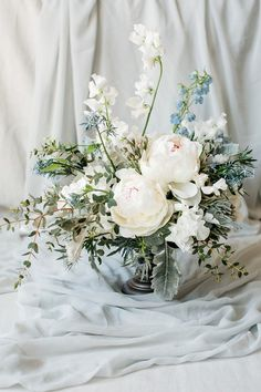 Blousy wedding blooms | Image by Tony Gigov