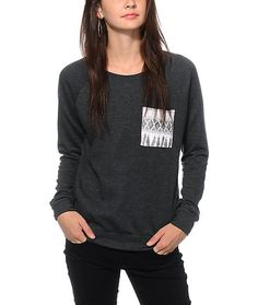 Let your style take flight with this relaxed fit sweatshirt cut from a lightweight and comfortable terry fabric that features a tribal feather print chest pocket.