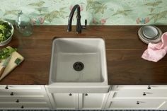 Bellera faucet   Whitehaven sink   Countertops with a beautiful black walnut wood grain add a farmhouse feel, especially when paired with a capacious…