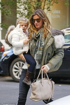 Just the two of us: Gisele was spotted carrying along the youngster after leaving the park