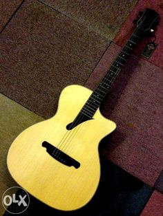 SQOE acoustic guitar... like the soundhole and bridge shapes