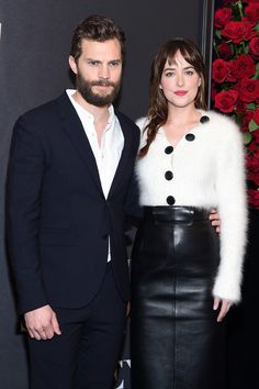 "Dakota Johnson Photos Photos - Actors Jamie Dornan (L) and Dakota Johnson attend the ""Fifty Shades Of Grey"" New York Fan First screening at Ziegfeld Theatre on February 6, 2015 in New York City. - 'Fifty Shades of Grey' Fan Screening"