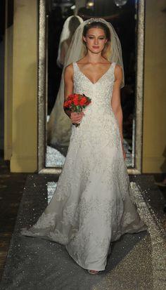 Wedding gown with v-neck neckline and beading embellishments | Oleg Cassini at David's Bridal Spring 2017 | https://www.theknot.com/content/oleg-cassini-davids-bridal-bridal-fashion-week-spring-2017