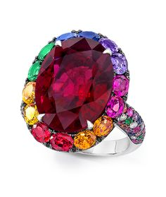 Cellini Jewelers Oval Red Tourmaline Ring 10.27-carat oval red tourmaline framed with diamonds, multicolor sapphires and tsavorites.