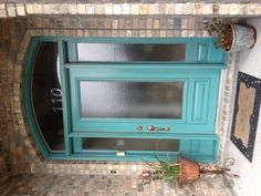 I painted our door in Backstroke from Lowe's, and used Valspar's Mocha glaze.  -TRM