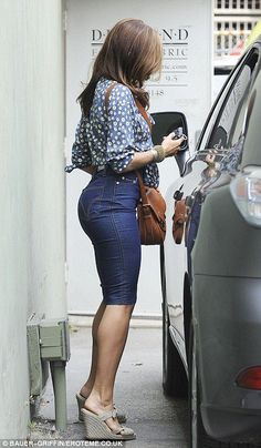 Eva Mendes dressed in a tight denim skirt