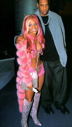 The first black Female Mc to start wearing colored wigs like this, and wear colorful crazy outfits like that, see.